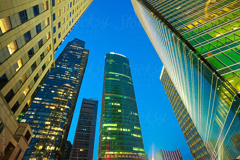 Looking at Shanghai Lujiazui modern city buildings Night by Wenhai Tang for Stocksy United