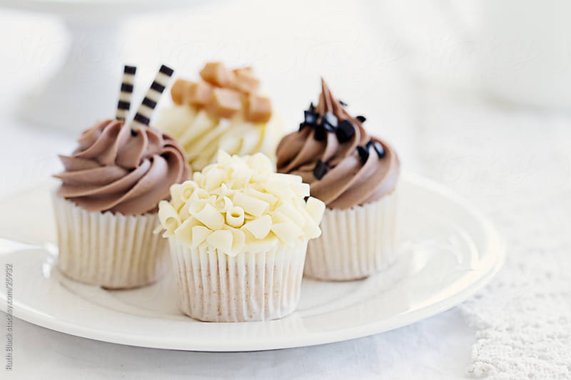 Chocolate cupcakes on a plate by Ruth Black for Stocksy United