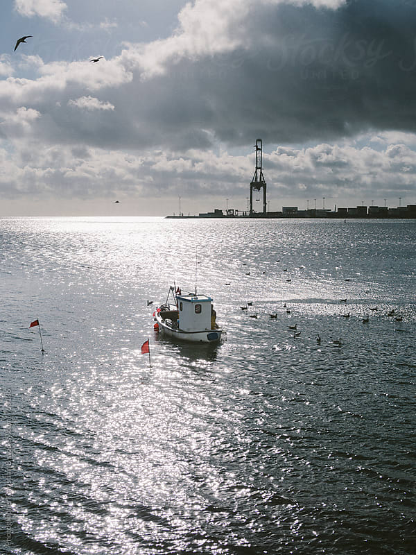 Small fishing boat by Photographer Christian B for Stocksy United