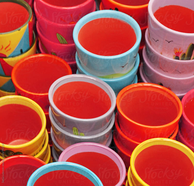 colorful pile of flower pots by Sonja Lekovic for Stocksy United