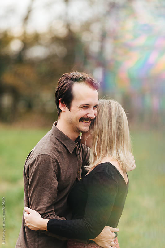 A young hipster couple giggling together by B. Harvey for Stocksy United