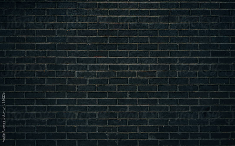Dark Brick Wall by Austin Rogers for Stocksy United
