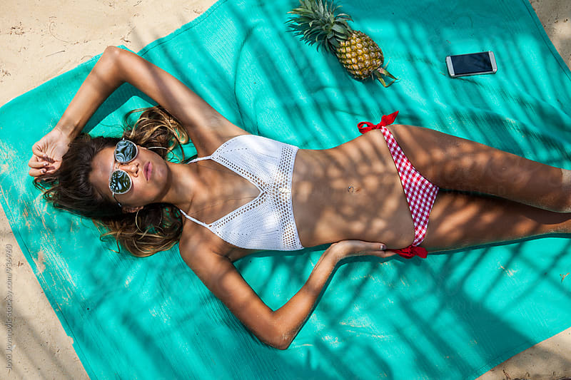 Beautiful woman relaxing at the beach by Jovo Jovanovic for Stocksy United