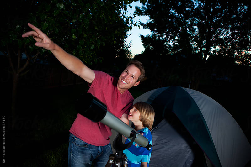 Camping: Dad Points Out a Planet to Son by Sean Locke for Stocksy United