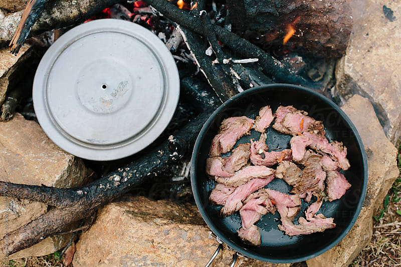 Campfire cooking by Gary Parker for Stocksy United