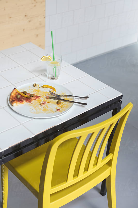 Pizza Slice on the Table by Branislav Jovanović for Stocksy United