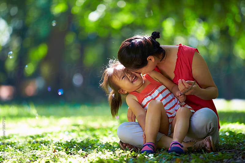 little girl with her mother in the sunny park by cuiyan Liu for Stocksy United