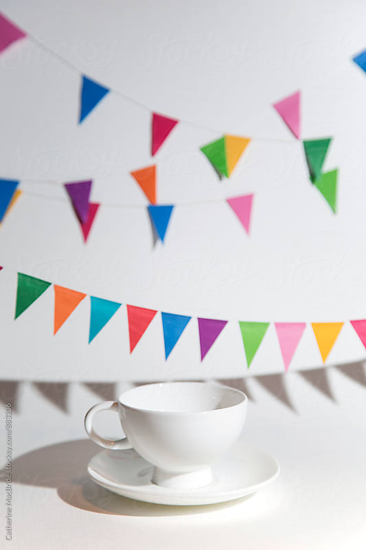 Bunting with tea cup by Catherine MacBride for Stocksy United