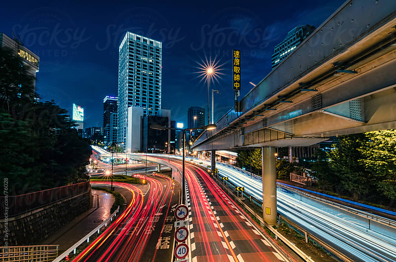 Cars Driving By On A Tokyo Highway by Leslie Taylor for Stocksy United