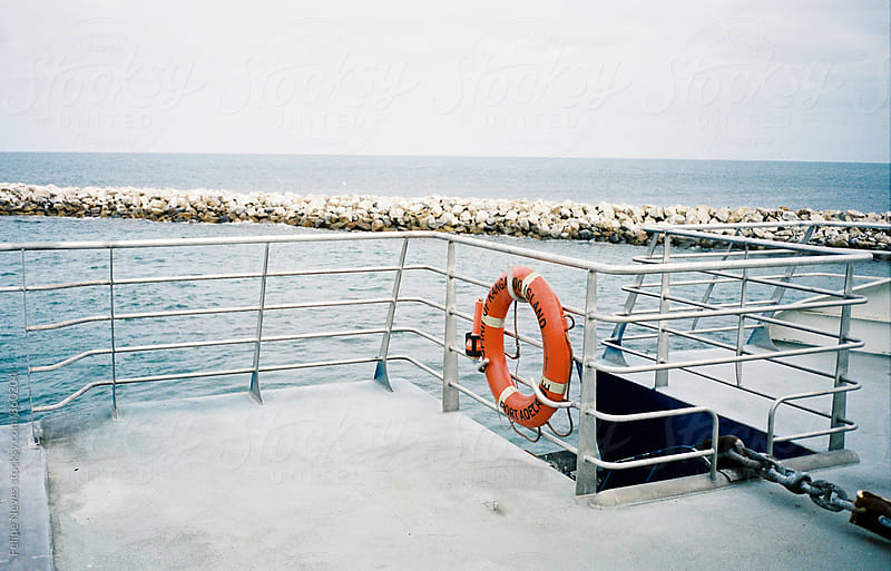 Life Buoy on a ferry by Felipe Neves for Stocksy United