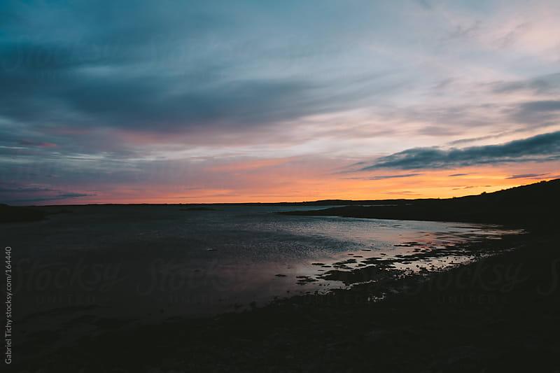 Dramatic sunset on coast by Gabriel Tichy for Stocksy United