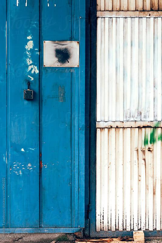 Blue wall background by Dimitrije Tanaskovic for Stocksy United