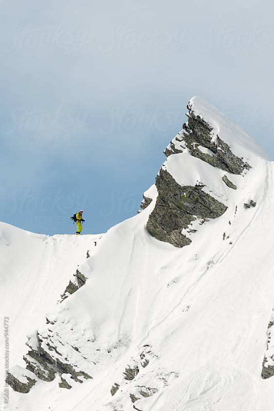 Skier on a steep snow ridge by RG&B Images for Stocksy United