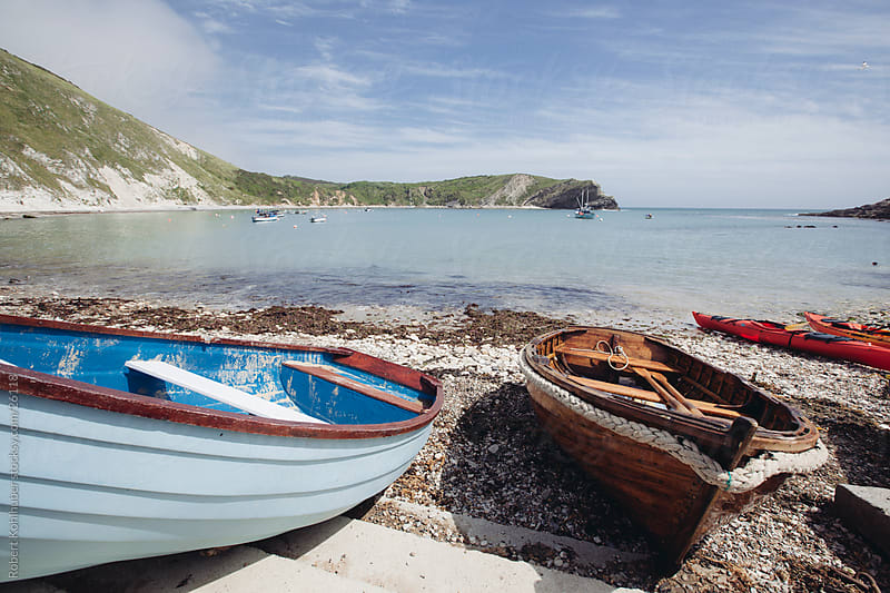 Boats on the beach in england by Robert Kohlhuber for Stocksy United