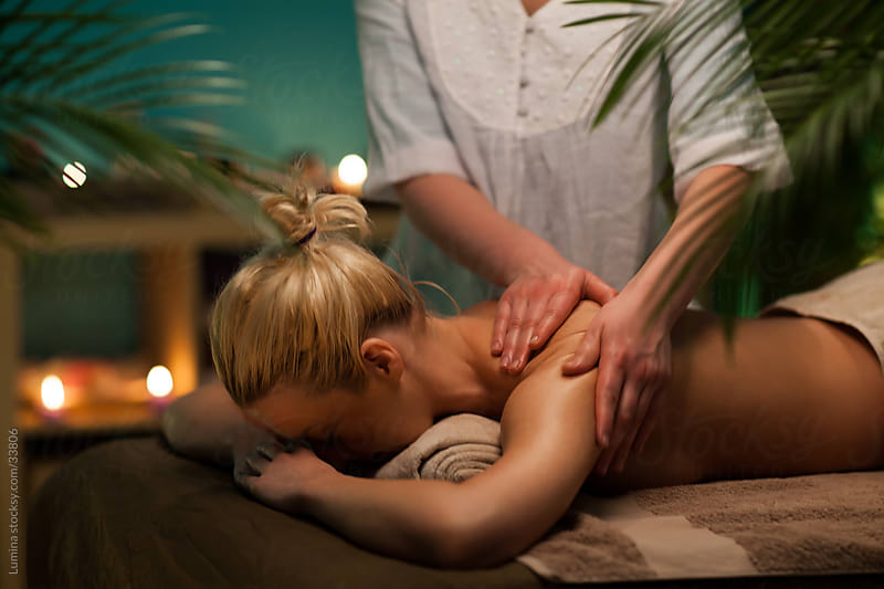 Woman Enjoying  a Back Massage by Lumina for Stocksy United