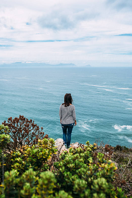 woman overlooking a sea view by Micky Wiswedel for Stocksy United