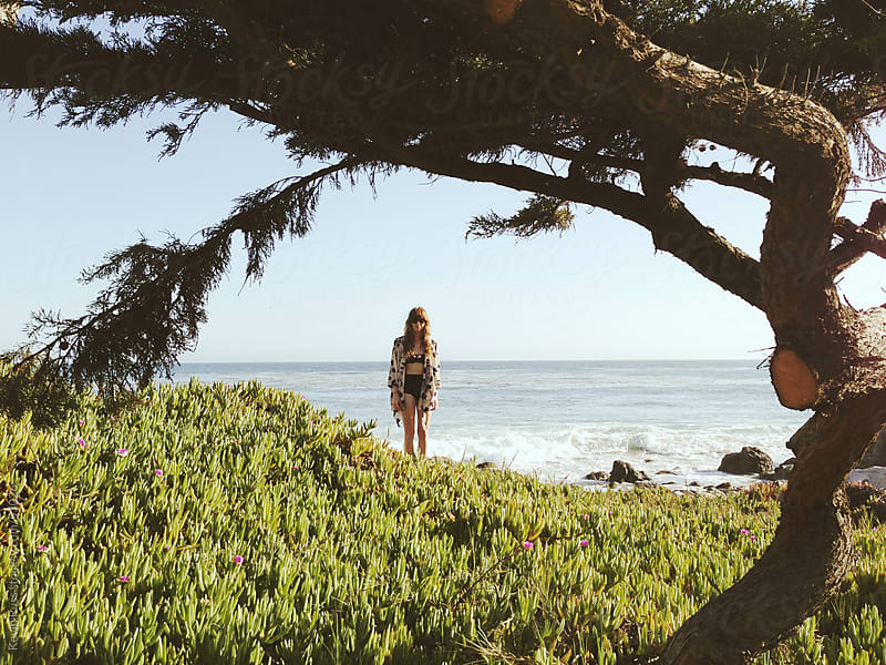 Beach Woman Framed With Nature by Kevin Russ for Stocksy United