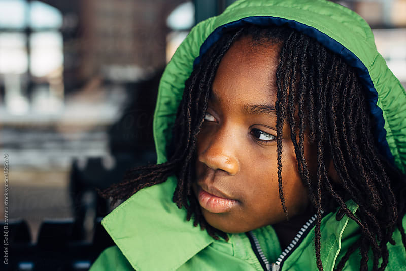 African American girl with green coat by Gabriel (Gabi) Bucataru for Stocksy United