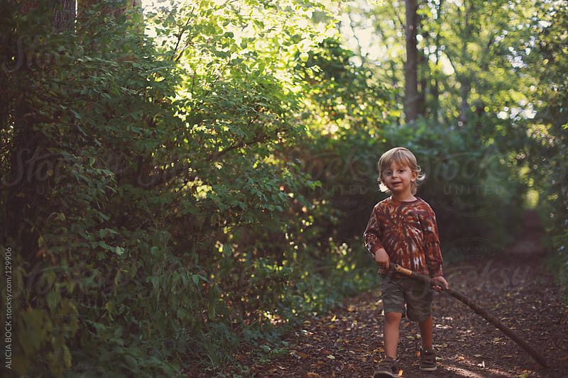 Boy With A Stick #2 by ALICIA BOCK for Stocksy United