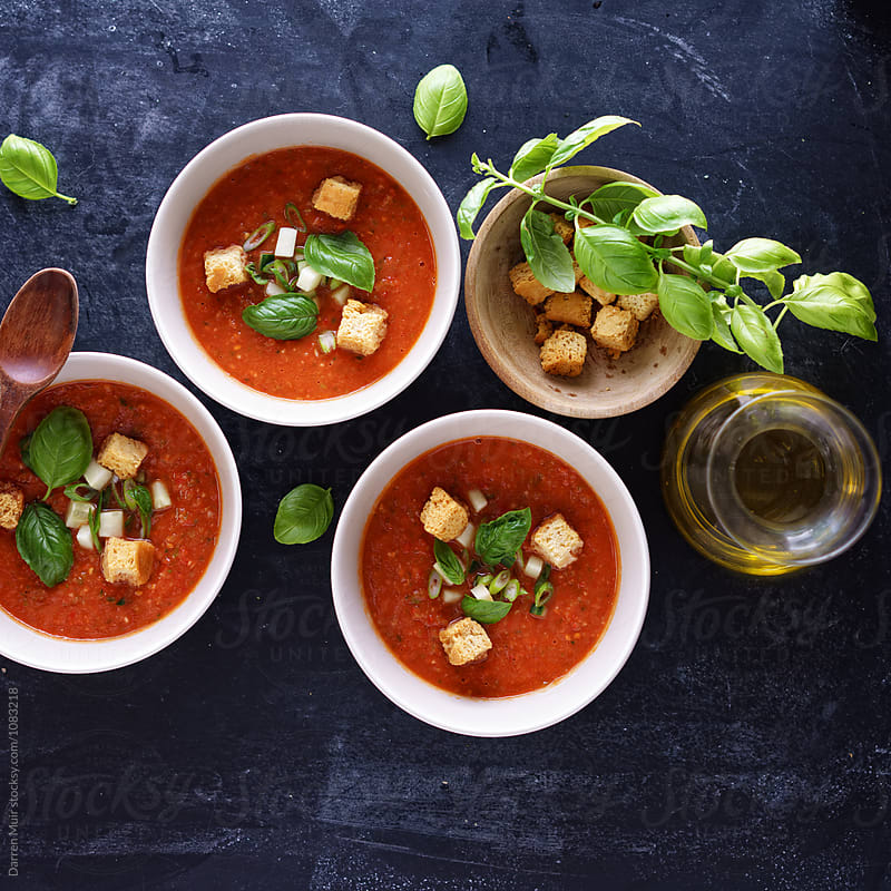 Gazpacho: Bowls of Gazpacho on a dark background. by Darren Muir for Stocksy United