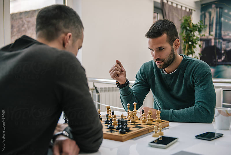 Friends Playing Chess  by Mosuno for Stocksy United