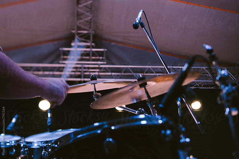 Drummer during concert by Pixel Stories for Stocksy United