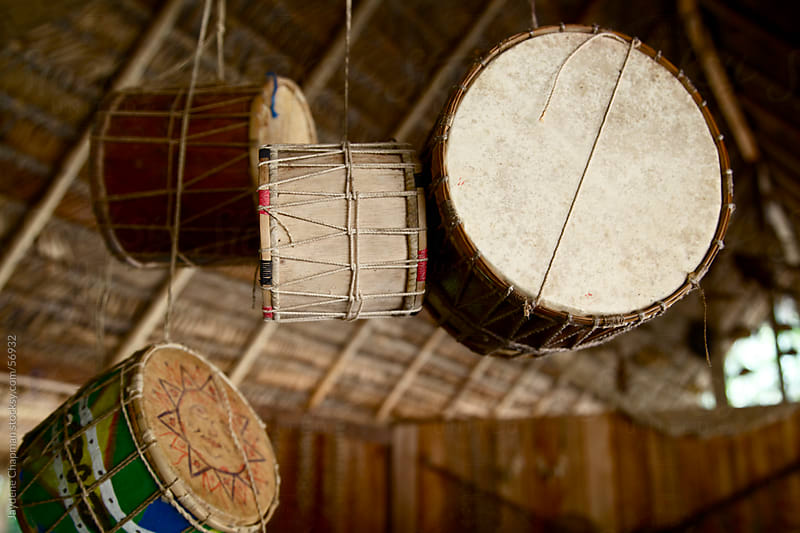 Handmade drums hanging from a traditional house ceiling, Banos, Ecuador by Jaydene Chapman for Stocksy United