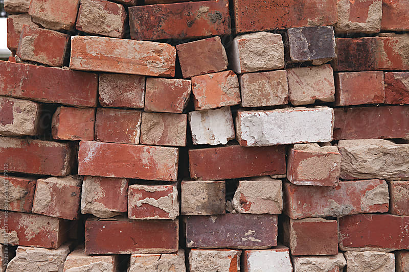 Stack of old red bricks by Natalie JEFFCOTT for Stocksy United