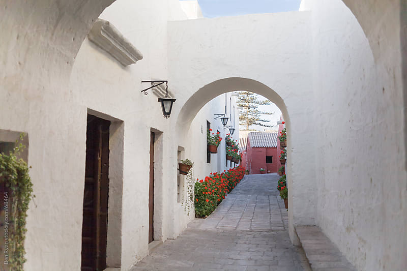 Travel: white adobe walls of an alleyway in a spanish colonial convent by Ben Ryan for Stocksy United