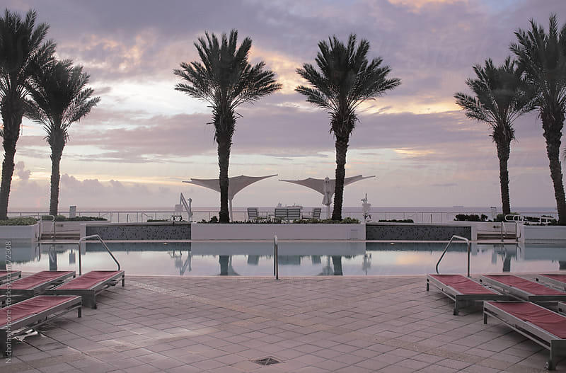 Sunrise on the pool deck by Nicholas Moore for Stocksy United