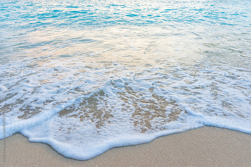 Peaceful foam waves on sandy beach by Trent Lanz for Stocksy United