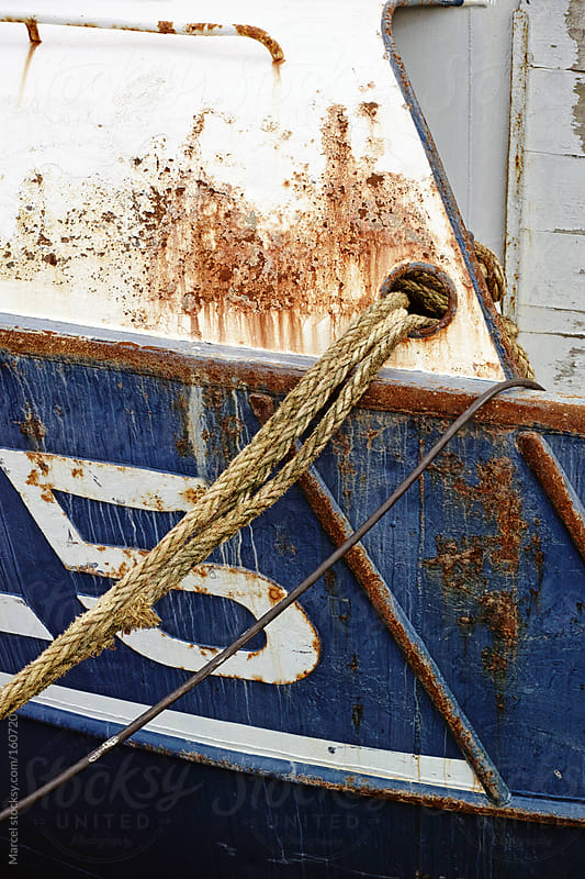 Detail of rusty fishing vessel by Marcel for Stocksy United