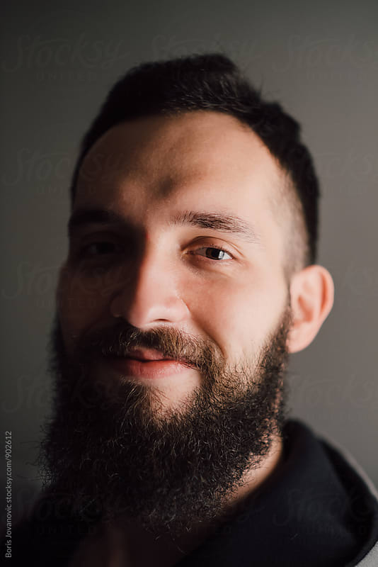 Portrait of charismatic bearded man  by Boris Jovanovic for Stocksy United
