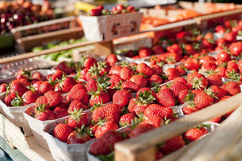 Food: Strawberries at a farmer's market by Ina Peters for Stocksy United
