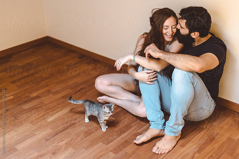 Couple at home with a cute cat by Good Vibrations Images for Stocksy United