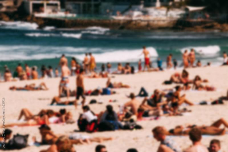 Out of focus crowded beach scene, Bondi Beach, Australia by Leandro Crespi for Stocksy United