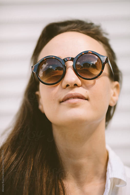 portrait of young woman with retro round sunglasses . by Vesna for Stocksy United