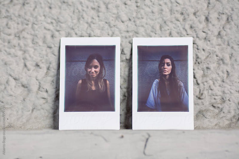Instant photos of two teenage girls by Alberto Bogo for Stocksy United
