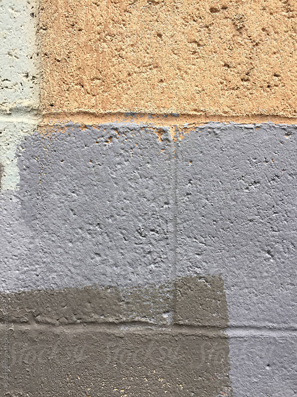 Paint covering graffiti tags on brick wall, close up by Paul Edmondson for Stocksy United