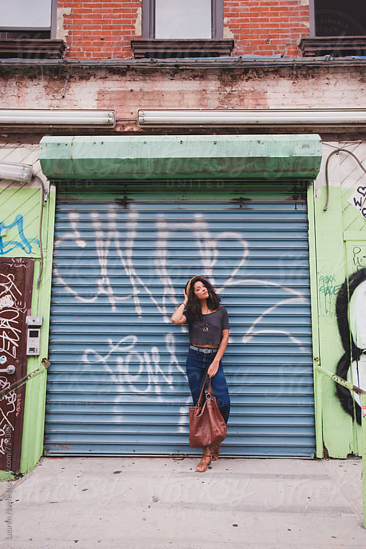 Stylish woman in the city by Lauren Naefe for Stocksy United
