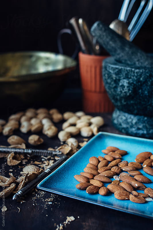 Shelled almonds on a blue plate by Gabriel (Gabi) Bucataru for Stocksy United