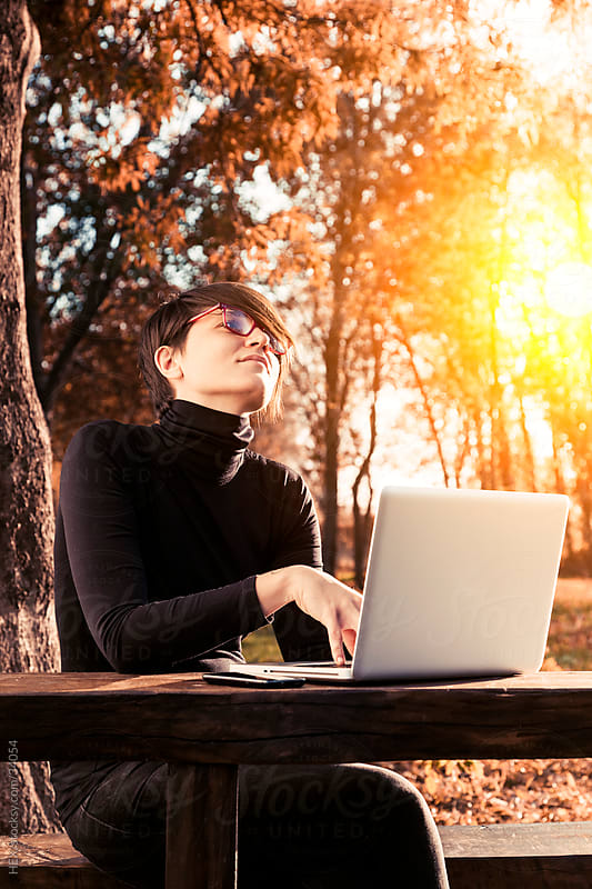 Woman Using Laptop Outdoor by HEX . for Stocksy United