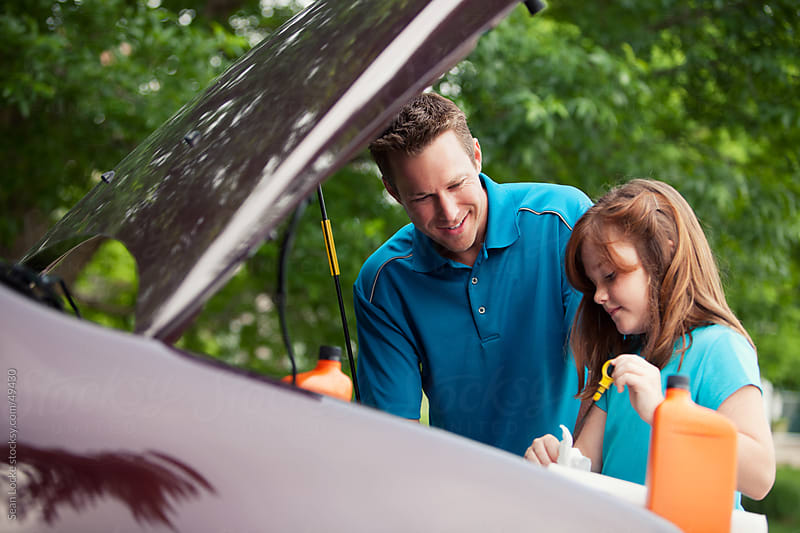 Father: Girl Checking Engine Oil Level by Sean Locke for Stocksy United