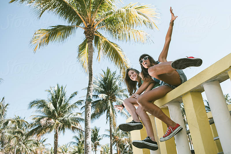 Two Young Women Friends Having Fun on Spring Break in Miami by Joselito Briones for Stocksy United