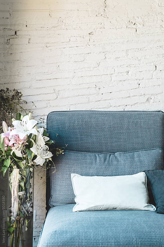 Grey sofa by Vera Lair for Stocksy United