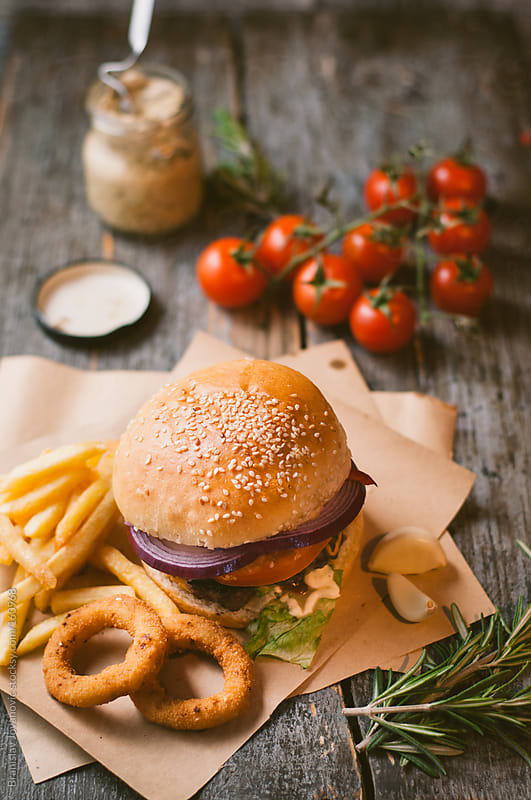 Beef burger with fries by Branislav Jovanovic for Stocksy United