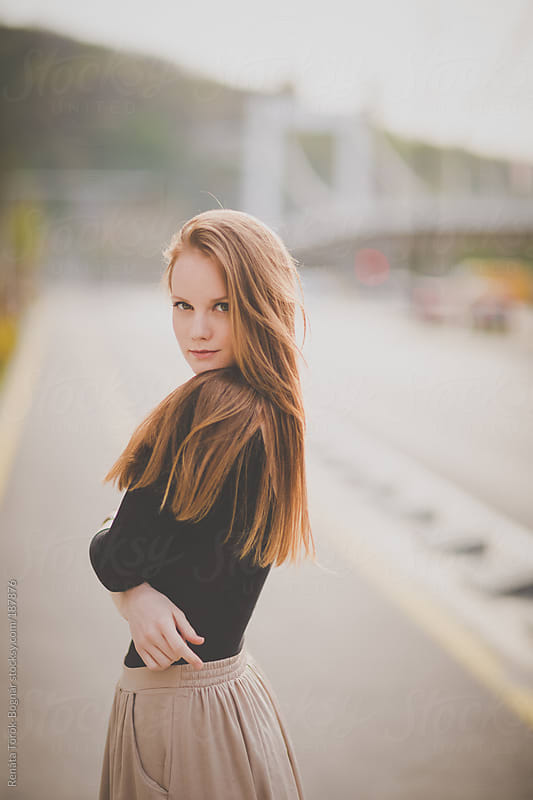 Beautiful red-haired woman in the city by Török-Bognár Renáta for Stocksy United