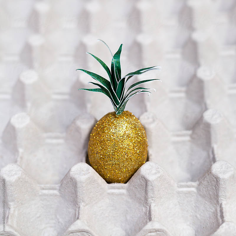 Pineapple Easter egg in a eggbox  by Jovana Milanko for Stocksy United