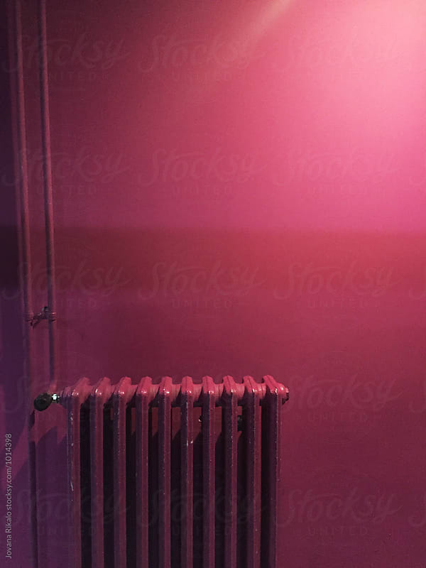 Radiator and pink wall by Jovana Rikalo for Stocksy United