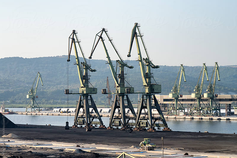 Bulk-handling cranes on coal dock by Pixel Stories for Stocksy United